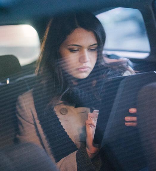 Uber passenger using tablet